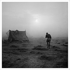 A soldier battling his way through a sandstorm in the Western Desert during 1942. CBM1358.jpg
