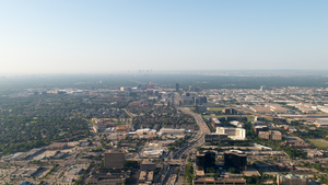 Aerial view of Addison looking south towards downtown Dallas.