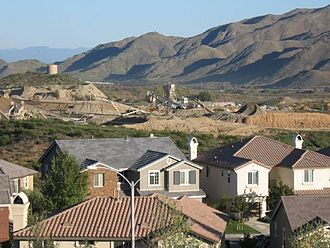 Lake Elsinore, California - Newly constructed housing tract in the Alberhill Ranch neighborhood. Pacific Clay Products company mine in background.