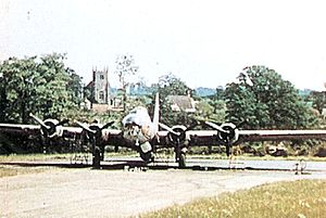 92d Operations Group - Unidentified 92d Bomb Group B-17F at Alconbury Airfield, summer 1943. In the background is a familiar sight to anyone who ever served at RAF Alconbury, the village of Little Stukeley