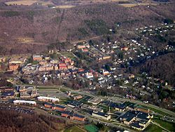 Aerial view of The Village of Alfred, taken April 2006. Visible are three horizontal layers. Central is the Village of Alfred, lower is Alfred State College, and at the upper-middle is Alfred University