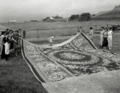 American artist Lillian Burke with Cheticamp hooked rug and the women who made it.tif