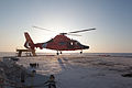 An MH-65 Dolphin helicopter crew takes off from the flight deck of the USCGC Healy (WAGB-20) 67 miles south of Nome, Alaska, Jan 120111-G-ZZ999-006.jpg