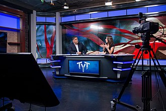 The Young Turks - Cenk Uygur (left) and Ana Kasparian (right) on the show's set in 2015