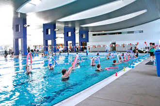 Aerobics - A water aerobics class at an Aquatic Centre.
