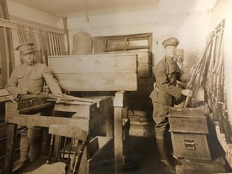District of Columbia National Guard - Enlisted men of the 1st Separate Battalion, an all African-American unit, examine weapons in the old army arms room prior to entering the War in Europe.