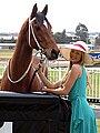 Australian woman with a horse (5721553548).jpg