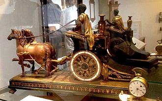 Chariot clock - A rare Austrian chariot clock, which had cases made out of wood, not bronze, c. 1810. National Watch and Clock Museum.