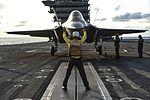 Aviation Boatswain's Mate (Handling) 3rd Class Juan Cumpston directs an F-35C Lightning II carrier variant to the catapult on the flight deck of the aircraft carrier USS George Washington (CVN 73) (28540439234).jpg