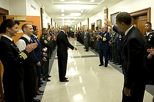 President Barack Obama waves goodbye after gre...