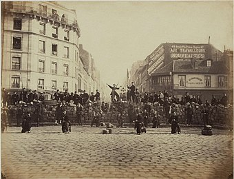 A barricade in the Paris Commune, 18 March 1871. Around 30,000 Parisians were killed, and thousands more were later executed. Barricade18March1871.jpg