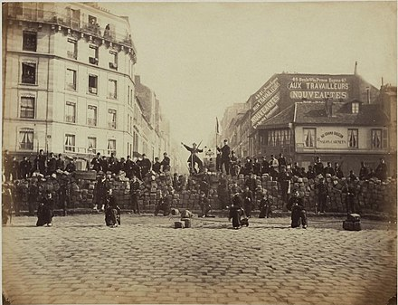A Parisian barricade set up by revolutionary forces of the Paris Commune in March 1871 Barricade18March1871.jpg