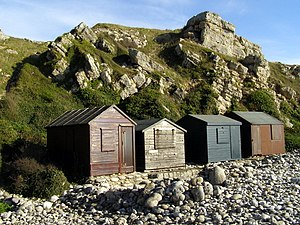 Church Ope Cove - The four east-most beach huts on the beach at Church Ope Cove.
