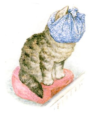 The Story of Miss Moppet - Miss Moppet sits before the fire with her head in a duster.