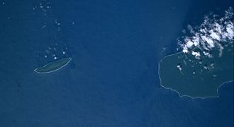 Bellona Island - Bellona is the small island on the left side; Rennell Island's northern end can be seen on the right of the picture. Courtesy NASA.