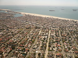The Belmont Shore neighborhood of Long Beach, California in the upper-middle of this image, with the Belmont Heights neighborhood in the lower half, looking southeast. 2nd Street cuts diagonally across the left of this image.