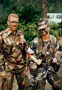 A Bermuda Regiment NCO with a (female) US Navy hospital corpsman, attached to the Bermuda Regiment from USNAS Bermuda, on training at USMC Camp Lejeune, 1994. The hospital corpsman wears a military combat uniform.