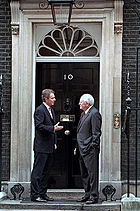Tony Blair and Dick Cheney at the main door to 10 Downing Street, the Prime Minister's residence in London, on 11 March 2002.