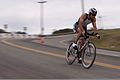 Blake Foster leans into a tight turn during the 56-mile bike ride through base during the Ironman 70.3 Triathlon at Oceanside, Calif., March 30, 2013 130330-M-LD192-006.jpg