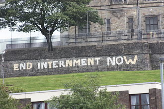 Operation Demetrius -  Modern anti-internment graffiti on Derry's Walls seen from the Bogside area of Derry