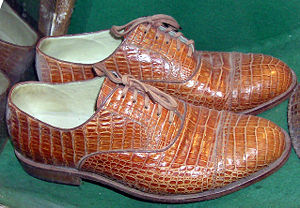 Shoes made from real crocodile skin, in a conservation exhibit at Bristol Zoo, England.
