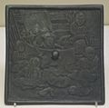 Bronze mirror depicting a puppet show.jpg