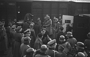Ordnungspolizei - Troops from the SS Police Battalions load Jews into boxcars at Marseille, France in January 1943.