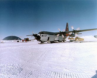 Military activity in the Antarctic - A United States Navy LC-130 Hercules near the Amundsen–Scott South Pole Station in 1996