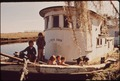 CHILDREN OF FISHERMEN PLAY ON SELDOM-USED BOAT - NARA - 545957.tif