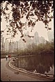COUPLE STROLL BY CENTRAL PARK POOL - NARA - 551776.jpg