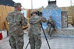 CSM Thomas Moore assists soldier 121022-A-FS017-901.jpg