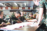 Cadets at Wittman Regional Airport, Wisconsin working at a table.jpg