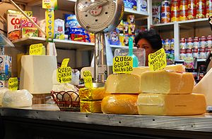 Cheeses of Mexico - Counter with various cheeses for sale at the Coyoacan market in Coyoacán, Mexico City