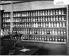 Chemicals on shelf in chemistry laboratory at Miami University 1911 (3183396462).jpg
