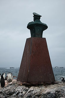 Chinstrap Penguins surround the monument to Piloto Pardo at Point Wild, Elephant Island.jpg