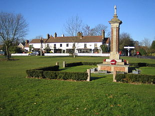 Chipperfield Common, The Two Brewers public house, war memorial and crossroads.
