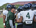 Chris Wiesehan, left, an assistant coach for the University of Hawaii football team, runs a drill during a practice at Joint Base Pearl Harbor-Hickam Aug. 15, 2013, in Hawaii 130815-N-IU636-213.jpg