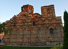 A Byzantine-style church decorated with blind arcades and missing entrances on this side