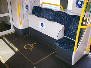 NSW TrainLink H set - Each vestibule has seats which can be folded up to allow room for wheelchairs and prams
