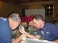 Civil Air Patrol Col. Rock Palermo, right, and members of the 82nd Airborne, participate in a conference call in Louisiana.JPG