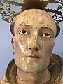 Closeup of head of carved wooden santo (statue) of St Bonaventure with carved robes and metal halo (14a9b0e9-448b-43f5-96bb-e2f10d1573ca).jpeg