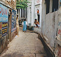 Crouching man and a woman India.jpg