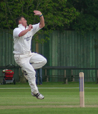 Overarm bowling - English cricketer Darren Gough about to deliver the ball overarm-style.