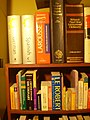 Dictionaries on a bookcase.jpg