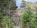 Discarded railroad ties, beside Cow River, PEI (41347901404).jpg