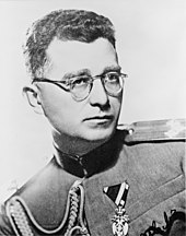 a black and white photograph of Draža Mihailović wearing glasses and Yugoslav Army dress uniform
