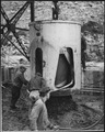 Dumping a four-yard bucket of concrete - NARA - 294150.tif