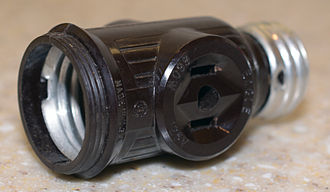 Eagle Electric - Screws into a light bulb socket to add two jacks, while still taking the bulb.  Made in the US by Eagle Electric.