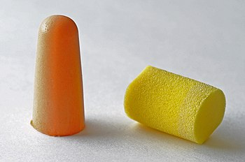 Two versions of earplugs. Yellow: E-A-R; Orang...