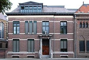 "Scholengemeenschap Augustinianum - One of the original buildings of the school, 8 Kanaalstraat in Eindhoven. Above the door, the text ""Gymnasium Augustinianum"" can still be read."